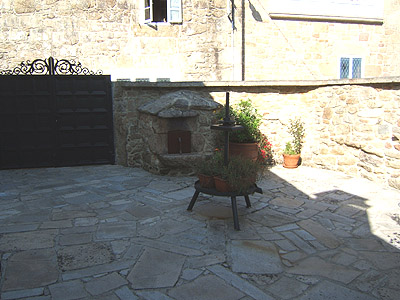 Other side of patio with entrance gate.