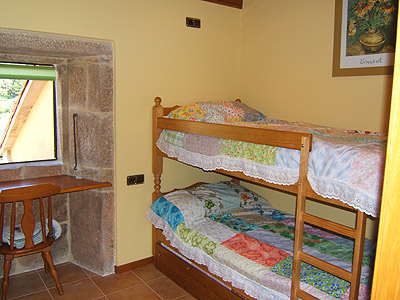 Third bedroom with bunk beds and extra bed