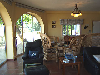 Other side of living room with views to the sea